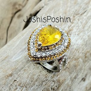 Silver pear shaped canary yellow citrine ring